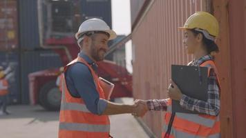Business Logistics Concept, Foreman Shake Hand with Worker and Control Loading Containers Box of Cargo Freight Ship for Logistic Planning and Explain Work with Young Woman video