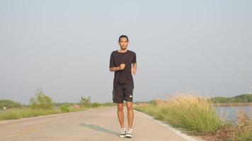 Asian Runner Runs on Street in Countryside with Fresh and Clear Air, Man Running or Workout for Good Healthy, Healthy Care Concept