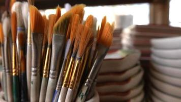 Painting Brushes in Ceramic Workshop