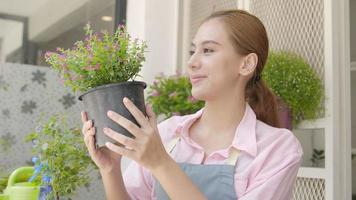 Small Business. Happy Asian Female Florist Takes Care Her Fresh Flower Plant, Holding Pot of Tree, Seller or Gardener Caring for Planting and Worker in Flowers Shop