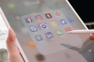 Chiang Mai, Thailand, Mar, 21, 2021 - Person using social media on an iPad photo