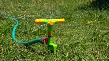 Water Sprinkler Squirts Water to Grass