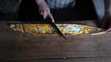 Cutting Turkish Food Pide