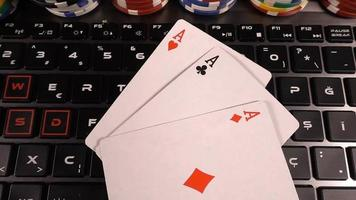 Poker Cards and Money Chips on Computer Keys