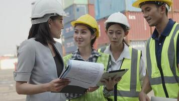 Business Logistics Concept, Foreman Planning and Meeting with Worker, Control Loading Containers Box of Cargo Freight Ship for Logistic Planning and Explain Work with Young Worker