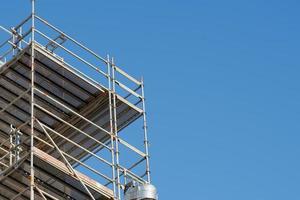 Construction scaffolding against a clear blue sky photo