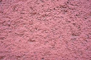 Painted pink wall textured background photo