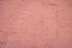 Painted pink wall textured background