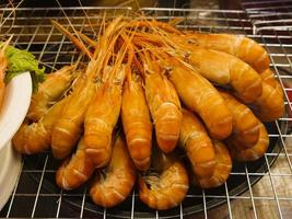 Steamed shrimp on the grill photo