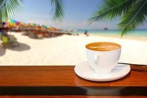 Cup of coffee with beach background photo