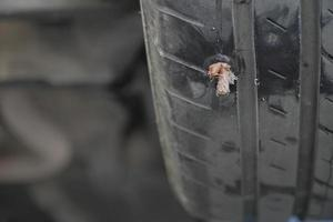 Close-up of a tire that has been repaired photo