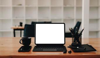 Tablet with black desk items mock-up photo