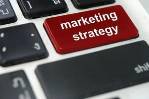 botón de teclado de estrategia de marketing foto