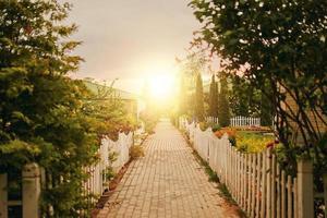 Sidewalk between cottages and gardens