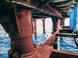Rusty metal bridge under the pier photo