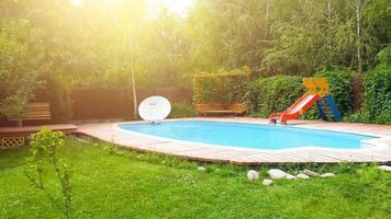 Backyard pool with slide photo