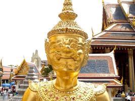 Bangkok, Thailand, 2021 - Wat Phra Kaew golden statue photo