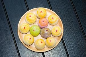 Chinese pastry on wood plate photo