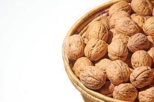 Basket of walnuts isolated photo
