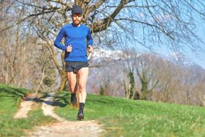 Man running on a trail photo