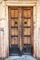 Antique rustic ancient wooden door photo