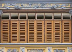 Antique wooden windows on an old building. Architectural elements. photo