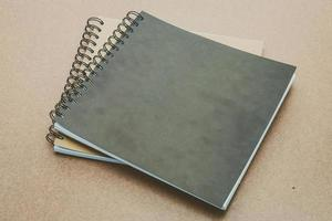 Notebook mock up on wood background