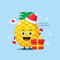 Cute pineapple mascot celebrating Christmas day vector
