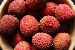 Lychees in wooden bowl