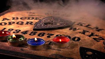 Ouija Board, Smoke, and Candles
