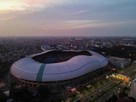 Bekasi, Indonesia 2021- Aerial view of the largest stadium of Bekasi from a drone with sunset and clouds photo