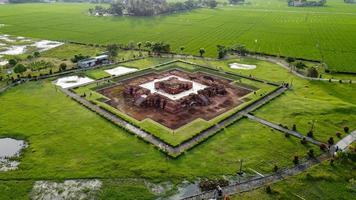 Karawang, Indonesia 2021- Aerial drone view of Blandongan Temple at Karawang and surrounded by green grass photo