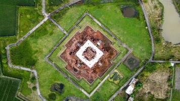 Karawang, Indonesia 2021- Aerial drone view of Blandongan Temple at Karawang and surrounded by green grass