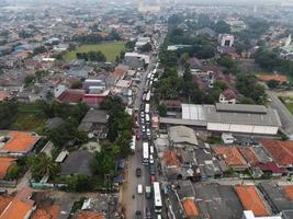 Bekasi, Indonesia 2021- Traffic jam on the polluted streets of Bekasi with the highest number of motor vehicles and traffic congestion