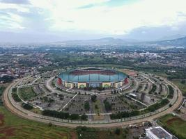 Bogor, Indonesia 2021- Aerial view of the largest stadium Pakansari Stadium from drone with clouds and sunset photo