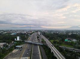 Jakarta, Indonesia 2021- Aerial view of Monorail movement on track moving fast taken at station Cibubur