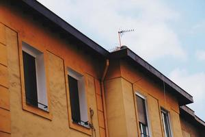Antenna tv on the rooftop of a house