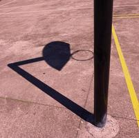 Street basketball hoop shadow silhouette on the court
