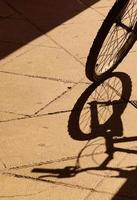 Bicycle shadow silhouette wheel on the street photo