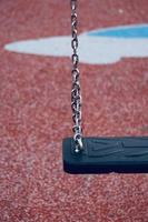 Swing on the playground photo