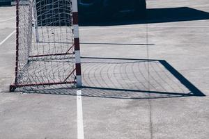 Street soccer goal shadow on the field