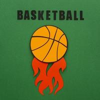 Paper cutout of a top view basketball with flames
