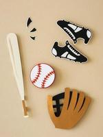 Paper cutout of baseball bat with sneakers and glove