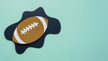 Paper cutout of American football with copy space