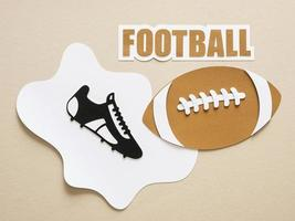 Paper cutout of flat lay American football sneaker