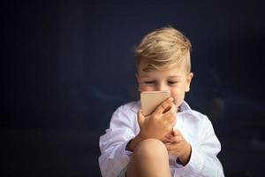 Small boy using smartphone photo