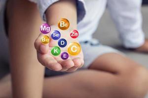 Vitamins and minerals for children, conceptual 3D photo
