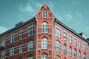 Symmetry architecture building corner against an overcast sky photo