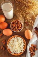 Cottage cheese, eggs, nuts and milk photo