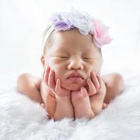 Newborn baby girl on white bed photo